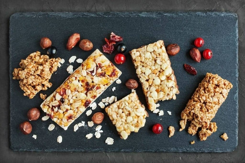 a baking sheet with homemade protein bars on them.