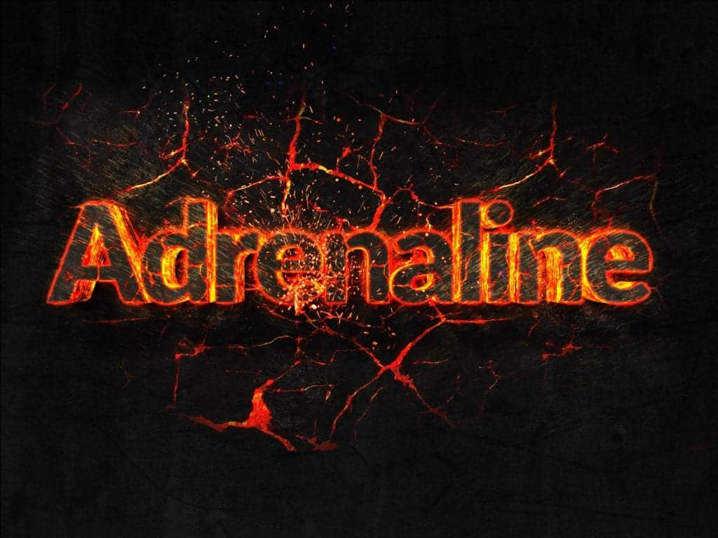Adrenaline Fire text flame burning hot lava explosion background. explaining that the supplement caffeine works to help build muscle