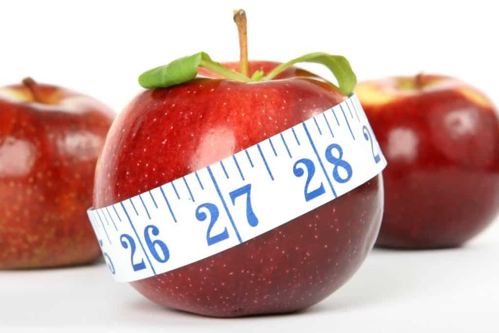 a picture of an apple and a tape measure to show you how eating well can help you lose weight