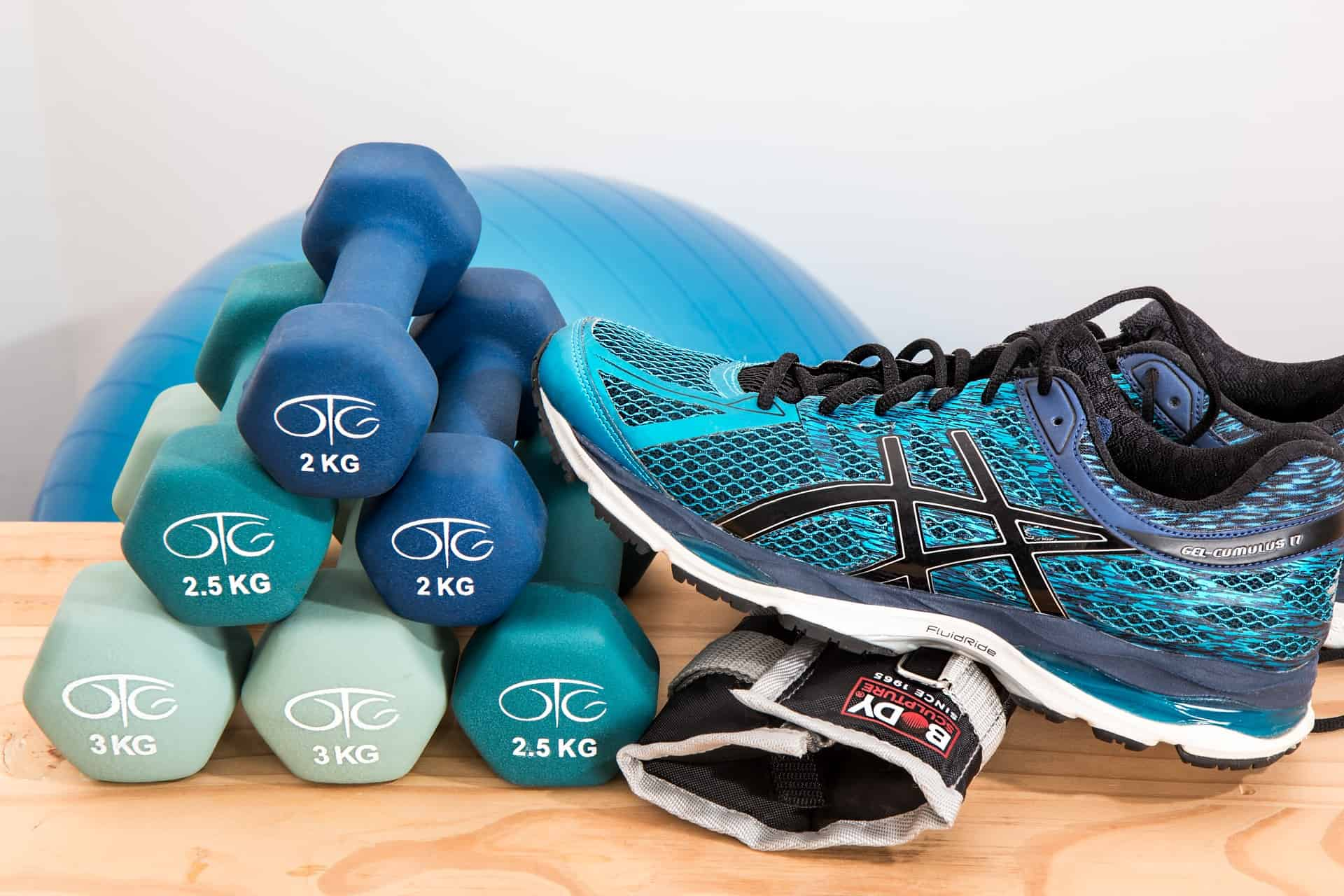 A picture of weights and running shoes