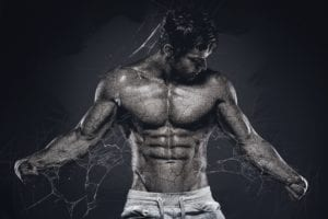 Bodybuilder with defined chest due to lower chest workouts