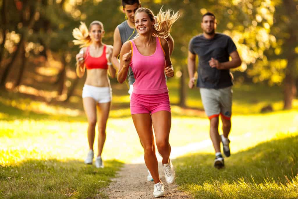 2 women and 2 men jogging as their cardio to lose weight