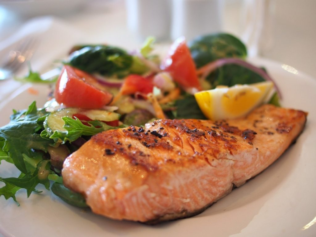 picture of a piece of salmon depicting what poly unsaturated fats would be like on a food label