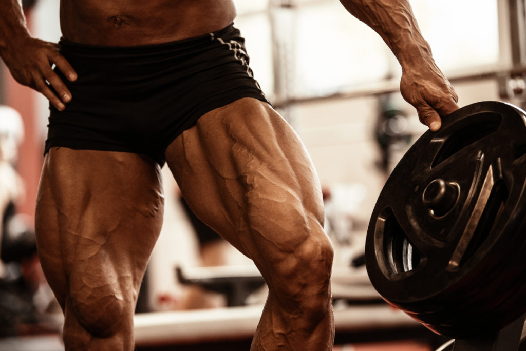 picture of a male bodybuilders massive legs after doing trap bar deadlifts