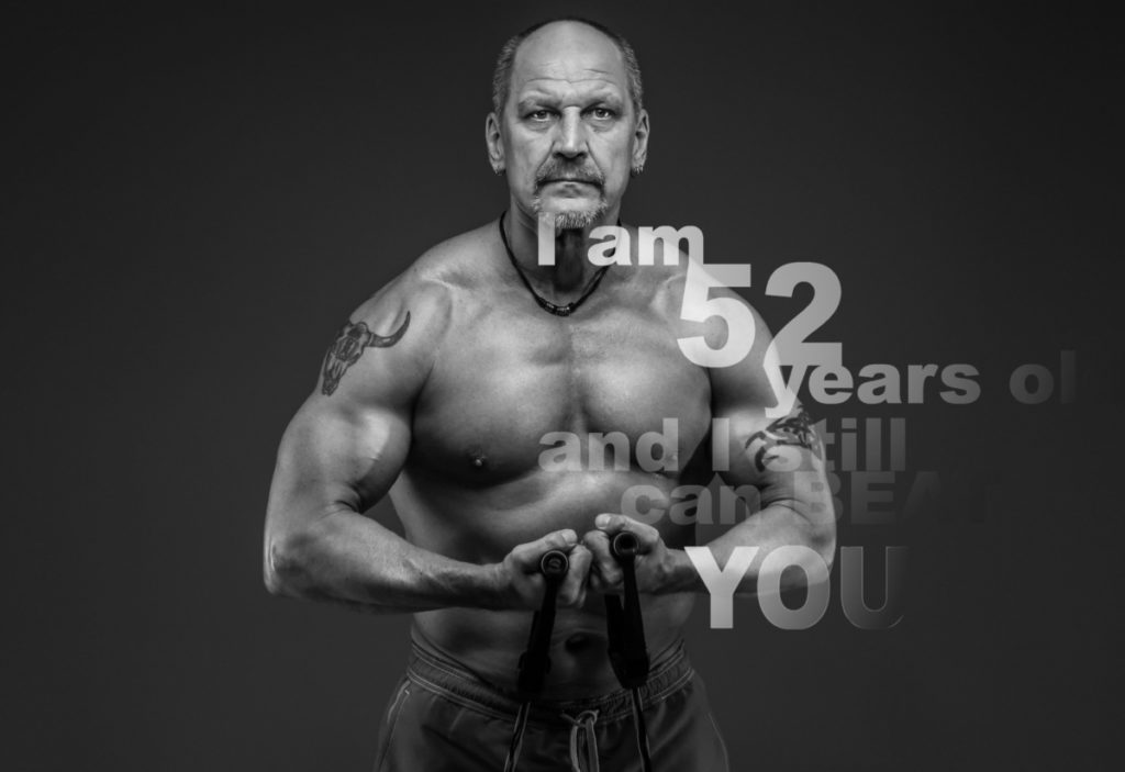 Middle age male with muscular body posing, showing you that you can build muscle after 40.
