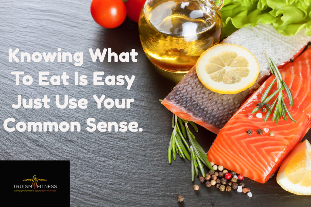 A picture of salmon filets and olive oil with test stating knowing what to eat is easy just use your common sense.