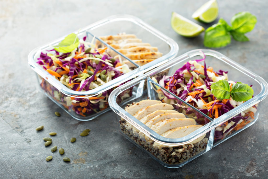 Healthy meal prep containers with quinoa, chicken and coleslaw