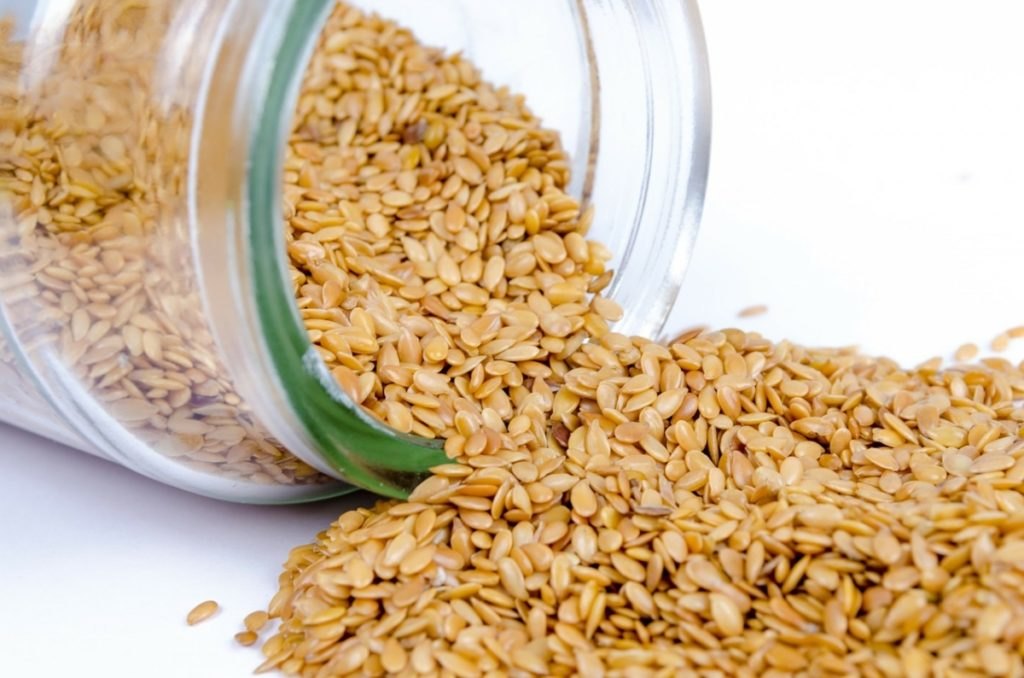 A jar of sesame seeds that are high in Leucine one of the three amino acids in vegan BCAAs