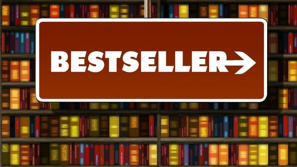 a picture of a bookcase with a sign in front saying bestsellers