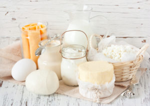 Fresh farm dairy products on a white wooden background. Tasty cheese, butter, eggs, milk and yogurt close-up. Also the main ingredient in Testogen as d-aspartic acid