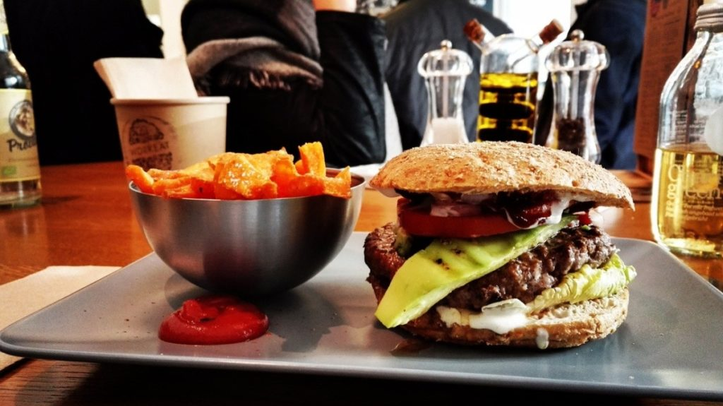 A picture of a burger and fries from a fast food restaurant, showing what not to eat when you're trying to build  muscle.
