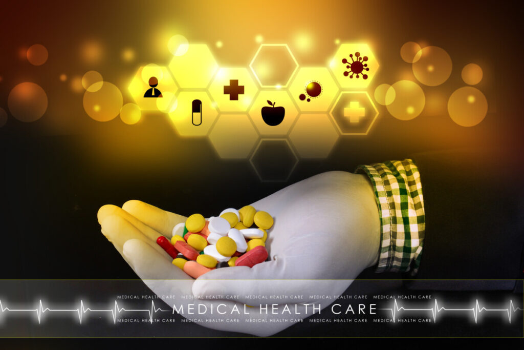 picture showing a hand holding a variety of pills