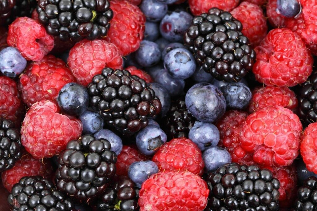 A picture of a basket of blueberries, blackberries, and raspberries which are an ingredient in vintage burn.