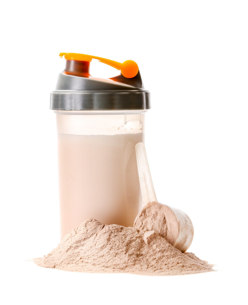 shaker bottle of whey protein before bed on white background