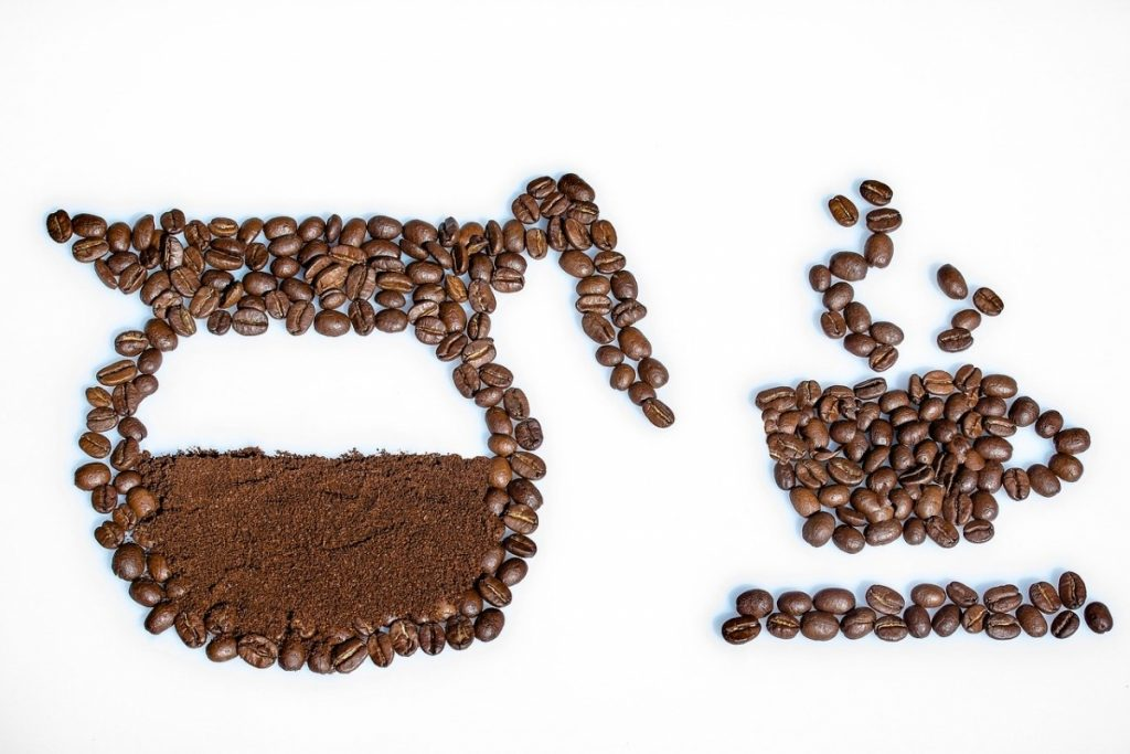 picture of a coffee pot and cup outlined in coffee beans