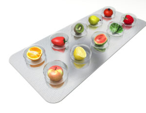 a capsule pack with fruits in the area where the vitamins would be showing how they are organic vitamins