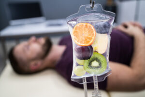 A saline bag filled with fruits referring to IV vitamin therapy