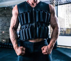 Bodybuilder wearing a Rogue weight vest