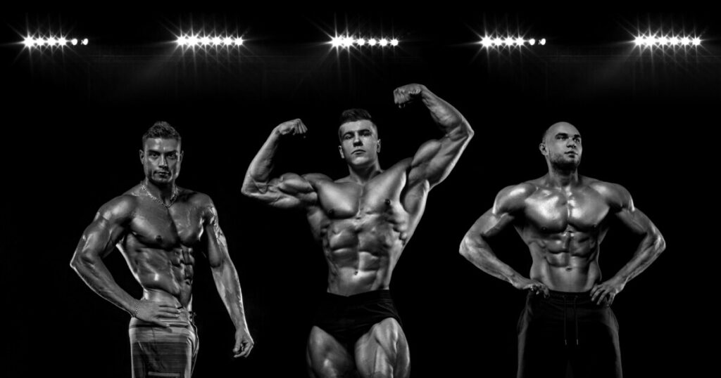 Sports wallpaper. Power athletic guy bodybuilder. Sportsman bodybuilder on black background with copy space. Sport concept.