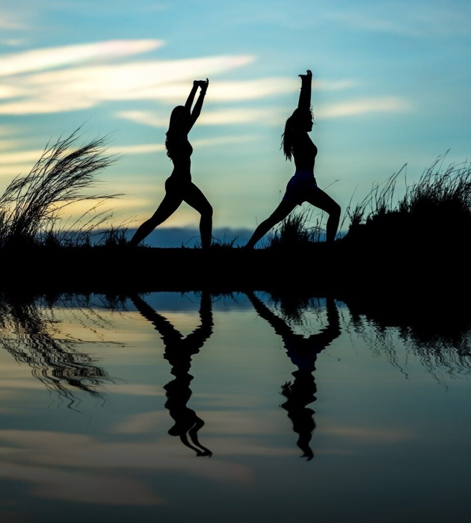 people doing yoga at dawn from having extra energy after drinking a protein shake before bed