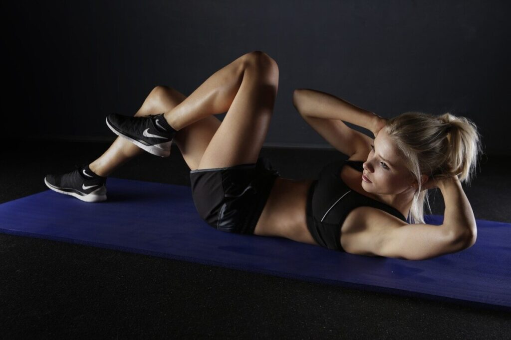 a pretty young blonde doing sit ups while taking zotrim