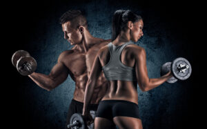 A young fit man and women following these 15 muscle building tips