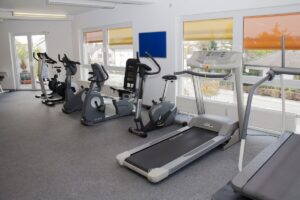 A home gym with a treadmill in it