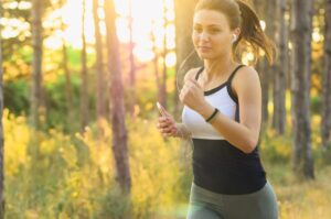 a young woman exercising outdoors for a morning jog