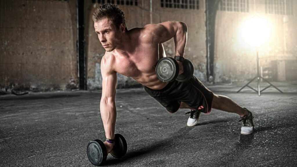 a young man doing push ups showing the muscle definition he achieved by using t bal 75 elite series